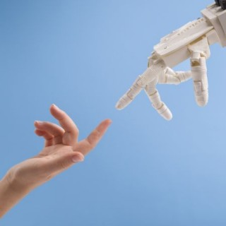 female-and-robot-hands-reaching-to-each-other-on-b-6289XC_20200401-204118_1
